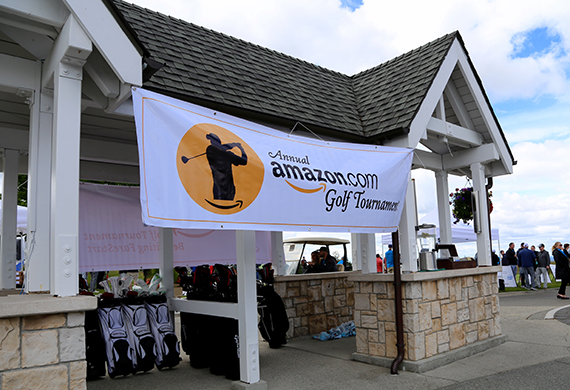 Amazon Golf banner hanging from an outdoor structure at a golf course