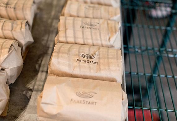 Brown paper sacks with FareStart's logo