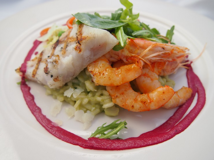 Risotto with shrimp and halibut from FareStart company catering