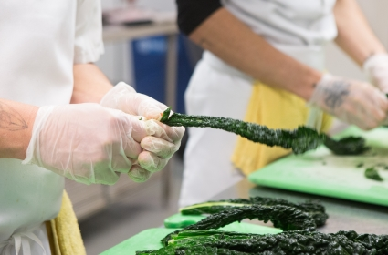 Adult Culinary Students prepare vegetables for community meals