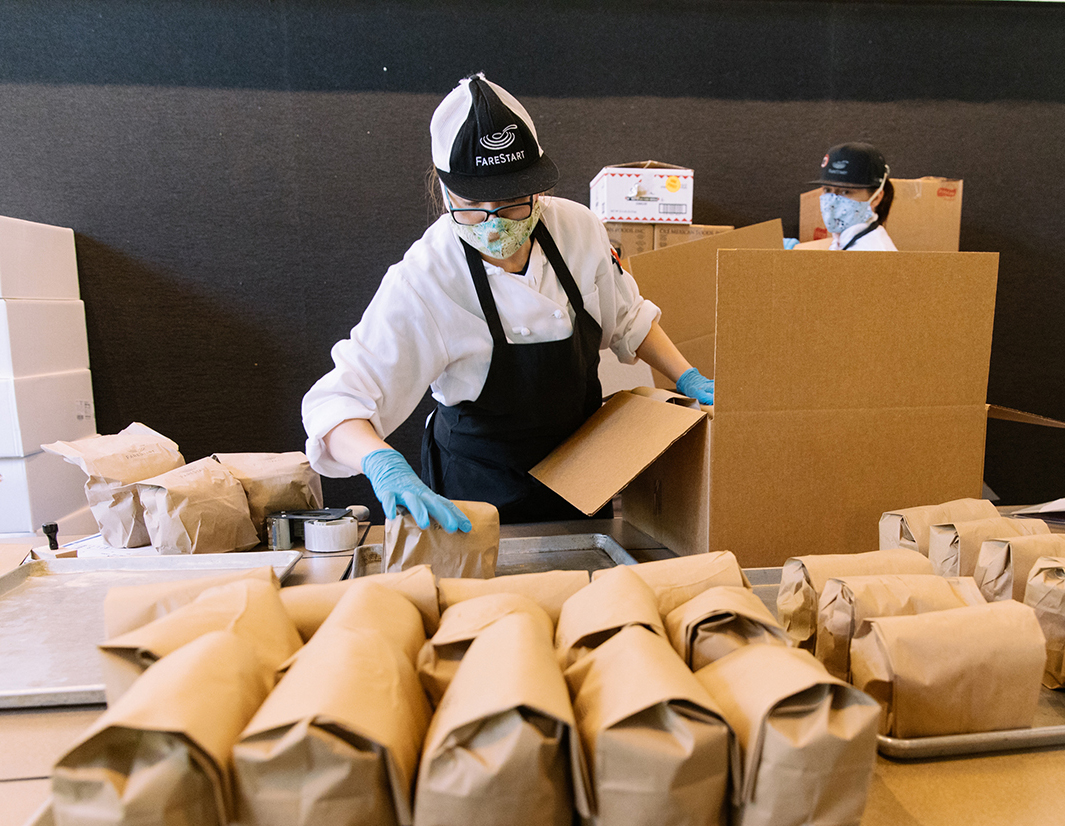 FareStart employee packing meals that will be distributed to those most in need in the greater Seattle area.